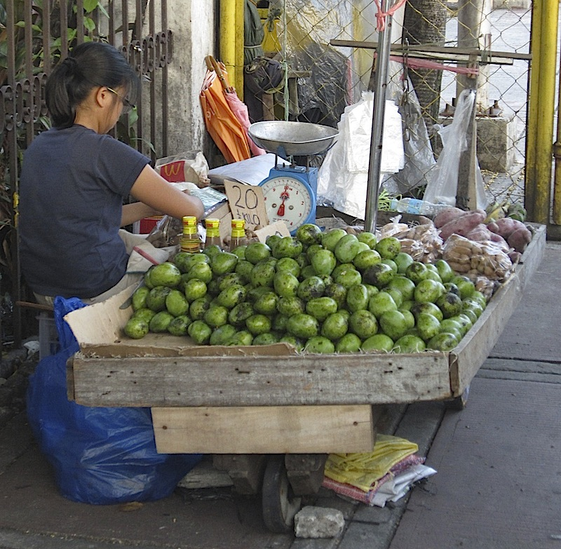fruit vendor on the sidewalk