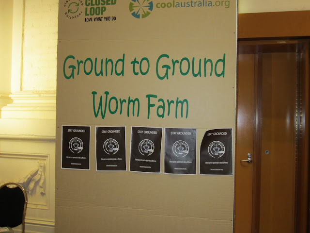 ground to ground sign with cafe posters
