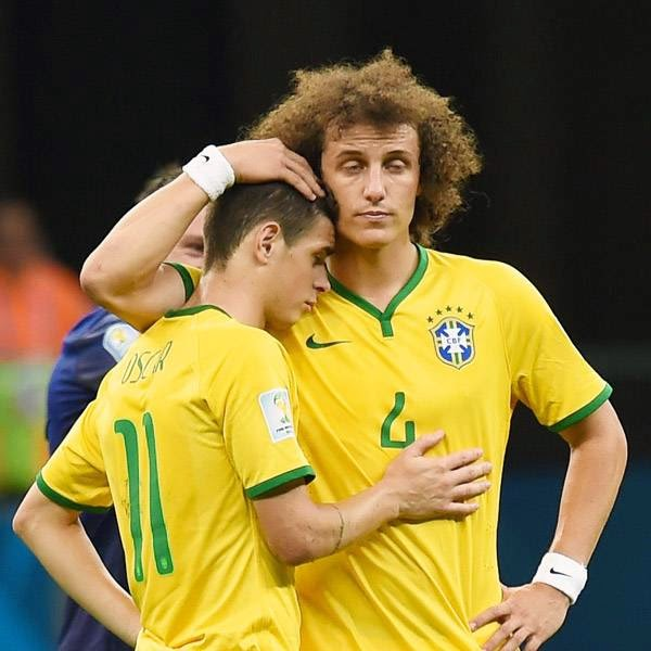 Brazil's defender David Luiz (R) and Brazil's midfielder Oscar react at the end of the third place play-off football match between Brazil and Netherlands during the 2014 FIFA World Cup at the National Stadium in Brasilia on July 12, 2014