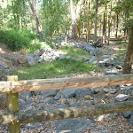 Dry rocky creek bed with timber barrier in Carnley Ave Reserve (400123)