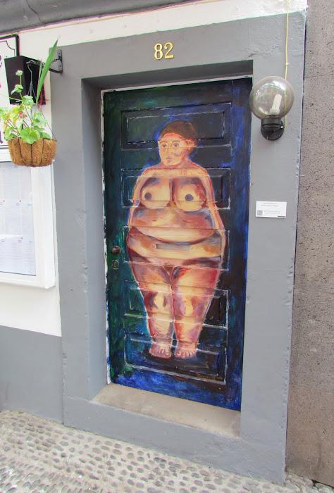 woman painted in a door - Rua de Santa Maria, old town