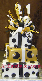 Three tier square white, black and gold polka dots and football helmets 21st birthday cake with a sugar bow topper