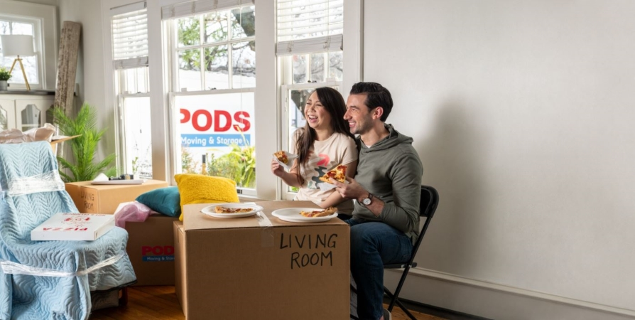 A couple enjoys pizza while they prepare for their move to Columbus, OH.