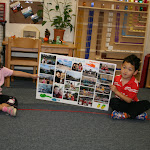 """While we don't have """"sharing time"""" like play-based preschool programs, we do invite children to share special trips, like this child who is sharing photos from a recent trip to Hawaii."""