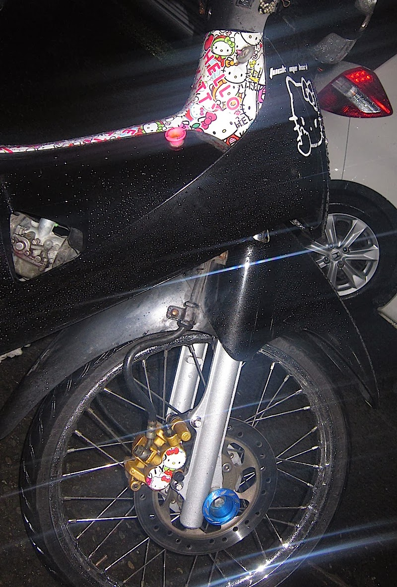 scooter with Hello Kitty decorations