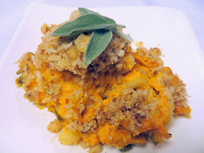 Pechluck's Pumpkin Mac and Cheese Recipe- uses less cheese because the pumpkin adds creaminess, and the toppings add great crunchy layer with the combination of panko and breadcrumbs, walnuts and parmesan