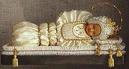 L'effige di Maria Bambina, la cui copia si trova anche presso il salone della Scuola dell'Infanzia-Asilo San Luigi di San Donà