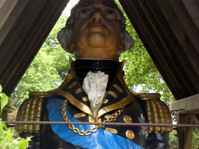 Painted wooden figurehead of admiral