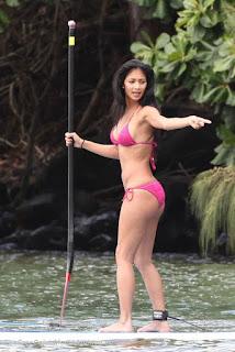 Nicole Scherzinger caught paddling in a river wearing a li'l pink bikini