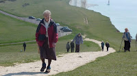 Valerie climbing up to Belle Tout