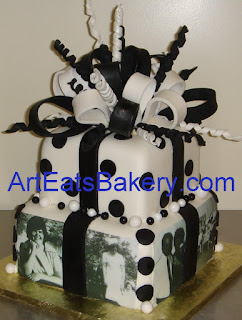 Two tier black and white fondant square custom birthday cake design with sugar bow and photos