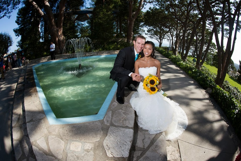 Bridal Couple in front of fountain at  Wayfarer's Chapel, Rancho Palos Verdes, CA-United States of America