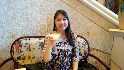 Enjoying a Wynn Signature Sip of The Pear-a-sol, Parasol's signature cocktail at Parasol Down. The cocktail includes Absolut Pears Vodka, Belle Paire Pear Liqeur, pear puree, and fresh sweet and sour along with complimentary snacks