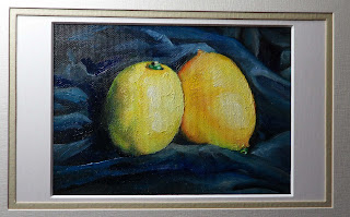Daily Painting, oil painting of two lemons sitting on a ruffled blue silk background