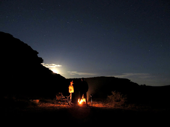 At the camp fire as the moon rises