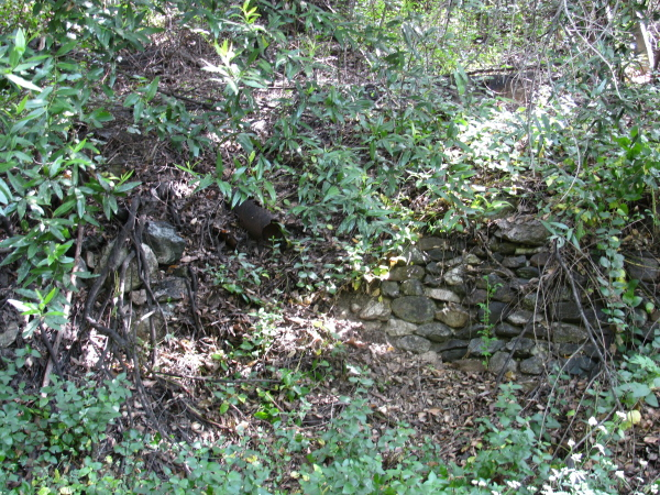 stone wall holding up the hillside
