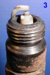 Свеча от двигателя с бедной топливно-воздушной смесью