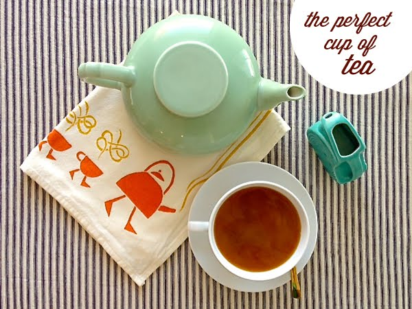 the perfect cup of tea with vintage tea pot, fiesta ware creamer, slide sideways tea towel, pretty gold spoon and crate and barrel tea cup