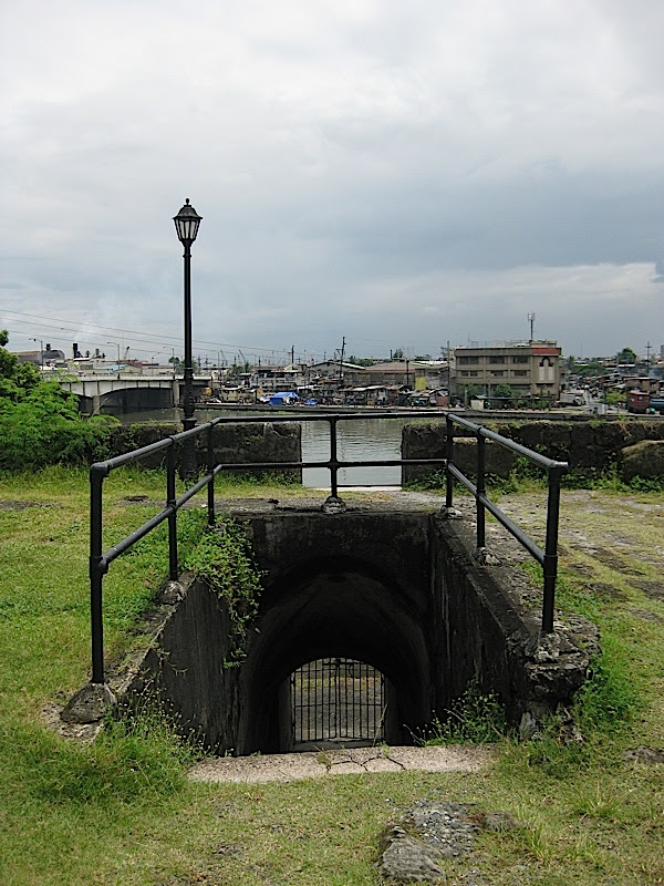 stairs through the wall of Fort Santiago to Pasig River