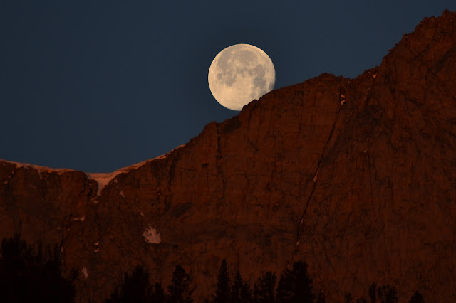 moon setting into the steep mountains