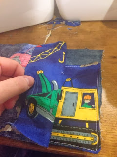 Pocket is sewn to a piece of jean fabric.
