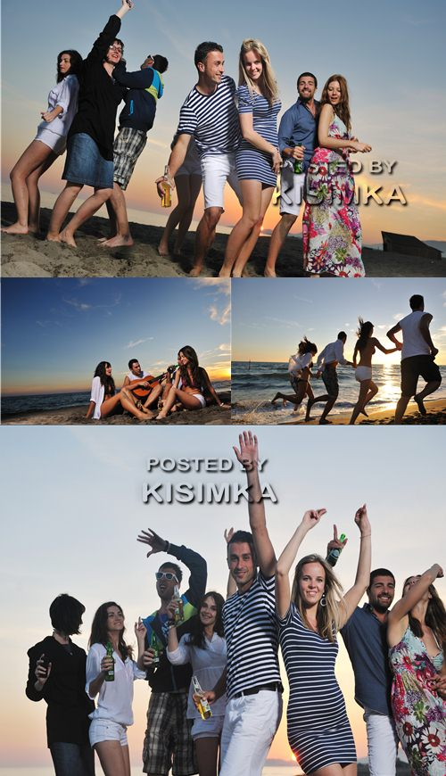 Stock Photo: Young people on sea coast