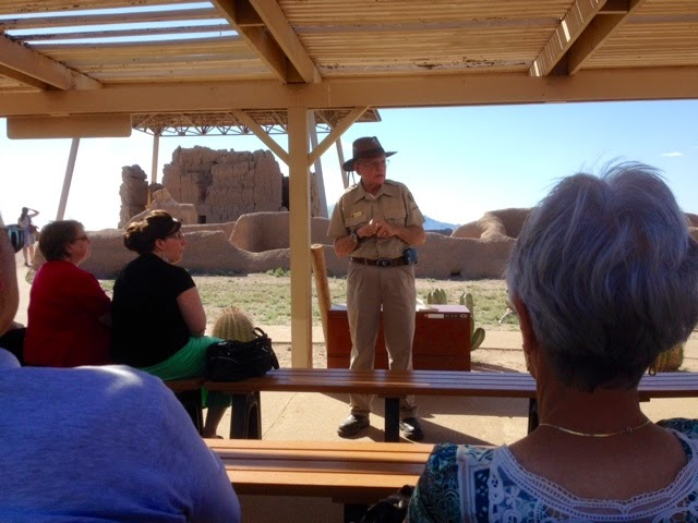 Guide speaks to audience at Casa Grande Ruin