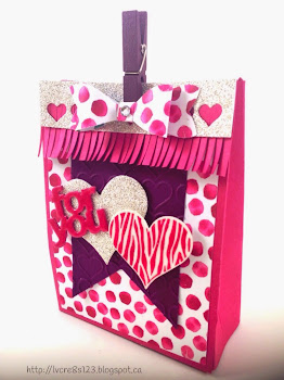 Llinda Vich Creates: Expanded Mini Treat Bag embellished with Painted Petals Designer Paper, fringed trim and punched Bow.