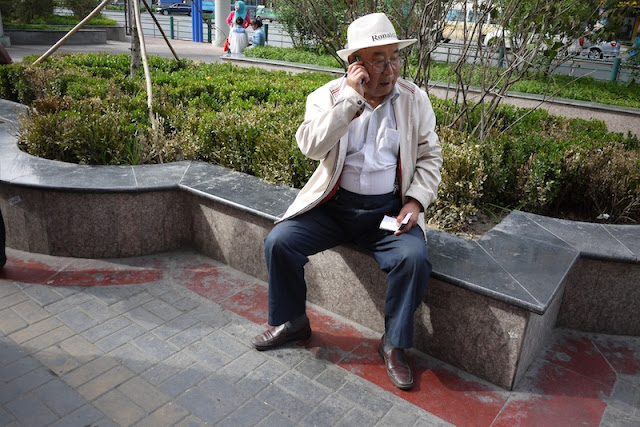 man talking on mobile phone in Xining, Qinghai, China