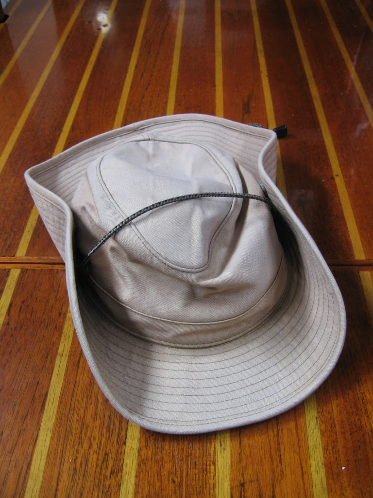 But variations on the Aussie bush hat have it all over the standard floppy  cruising hat. The advantage of the bush hat is that you can snap up the  brim on ... 1afb45f4a2f