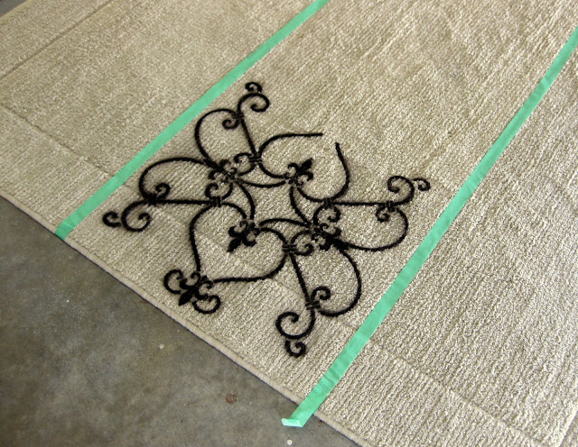 Remove the stencil, careful not to smudge the paint, and continue around the rug in the area you measured off