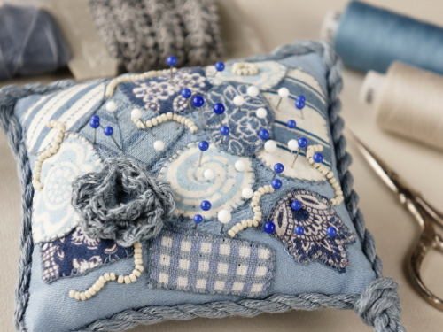Blue and white patchwork pincushion