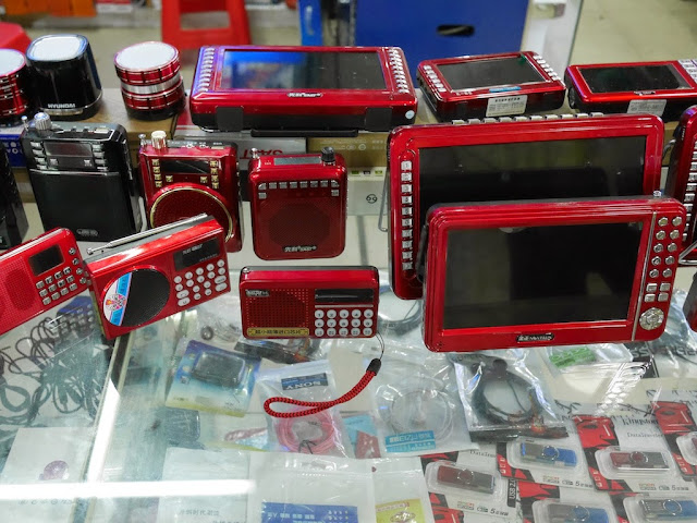 mobile audio and video players and USB flash drives for sale at a market in Hengyang, China