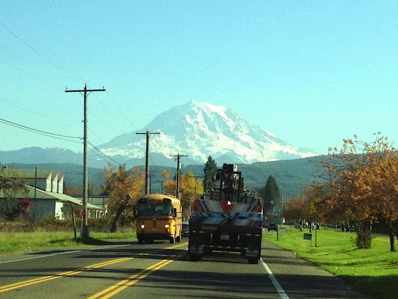 School bus in Orting, Washington with Mt Rainier in the background.