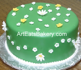 Green fondant custom sugar flowers birthday cake