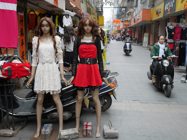 mannequins and woman on a motorbike in Yangjiang, China
