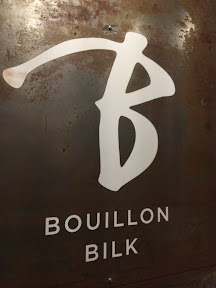 Sign of Bouillon Bilk, snuggled between two electronic shops in Montreal