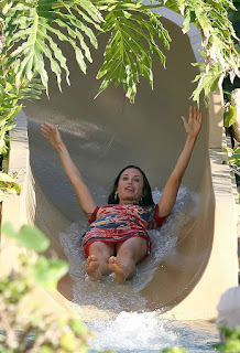Courteney Cox doing Water Slide