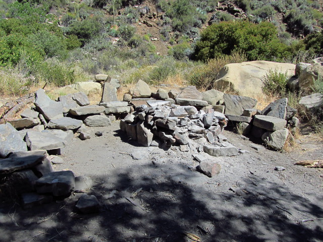 camp site with stone benches that are somewhat elaborate