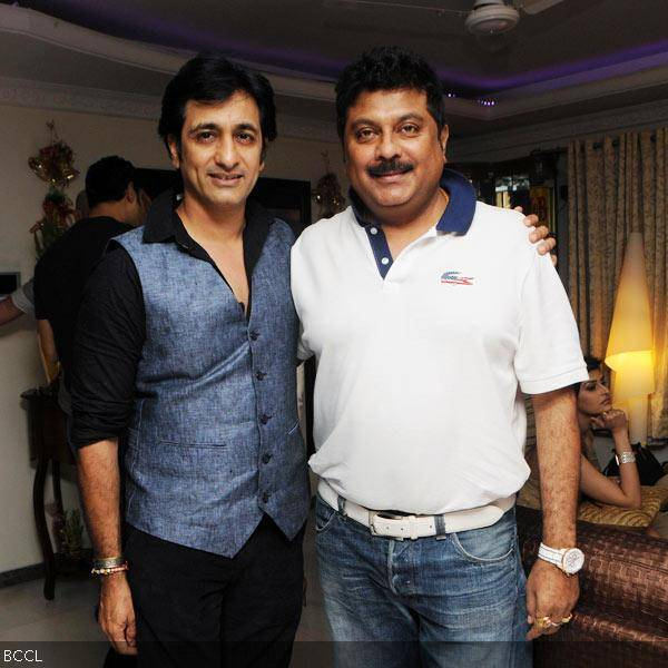 Rajeev Paul and Kapil Mehra pose for the camera during Sana Khan's 26th birthday celebrations in Mumbai on August 21, 2013. (Pic: Viral Bhayani)