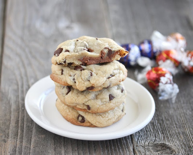 a stack of Truffle Stuffed Chocolate Chip Cookies