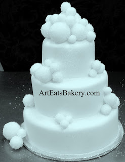 Three tier white pearl fondant wedding cake with crystal sugar snowballs