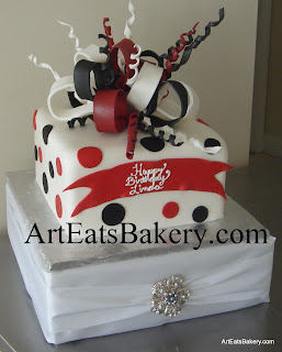 Red, black and white fondant polka dot custom creative birthday cake design with edible bow and ribbon curls