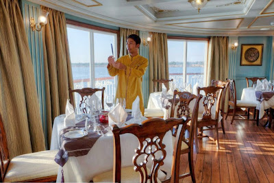 The Jahan's Viceroy Dining Hall The Jahan's elegant Viceroy Dining Hall is located next to the bar on the terrace deck and offers al-fresco dining with free style seating. Ascetically designed, the Viceroy Hall is day light flooded with many high windows. The hall in azure side walls, white ceiling with golden borders and elegant finished chairs and tables shows its full royal shine in the evening when British styled luster bathes the room in decent light.