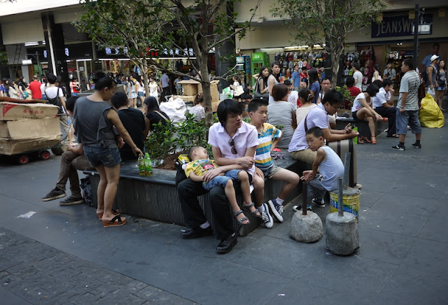 people sitting down at Dongmen shopping area in Shenzhen, China