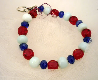 "American Beauty - Red & White glass with blue crystals 7 1/2 ""  $12"