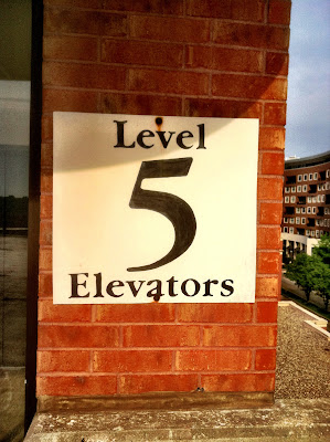 Level five elevator roof sign stock photo
