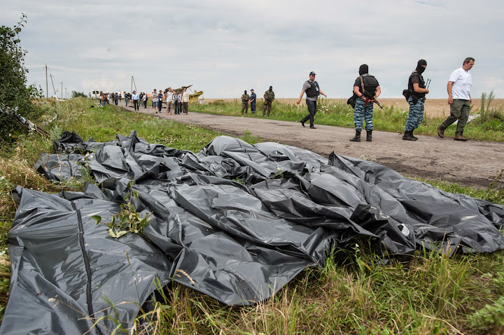 Bodies of plane crash victims and pro-Russian fighters at MH17 crash site