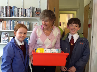 Margaret Farmer receives Harvest Gifts from Mark Cross School, presented by Katie and Monty.
