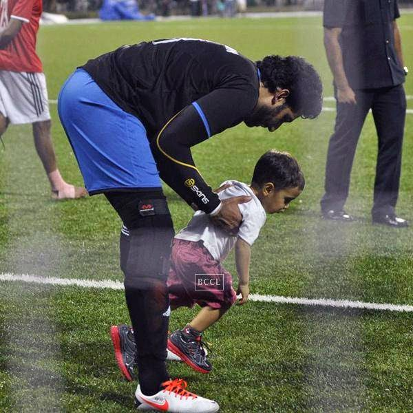 Abhishek Bachchan plays with Azaad Khan during a charity soccer match organised by Aamir's daughter Ira Khan, at Cooperage ground, on July 20, 2014.(Pic: Viral Bhayani)